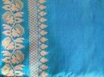 A blue sari with gold border detail.