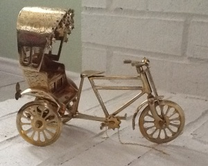 Miniature rickshaw made of brass.